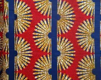 red and yellow patterned baby wrap