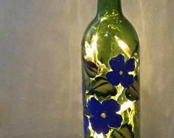 Recycled hand-painted light-up wine bottle decor!