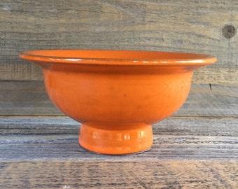Orange pedestal bowl
