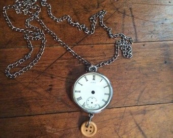 "Two-sided ""clock"" necklace"