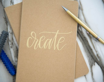 "Hand Lettered, Gold Embossed Large Moleskine Journal ""Create"""