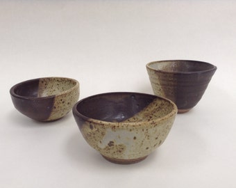 Beautiful matte vessels and tea bowls that are smooth, interesting, and soft to the touch. The majority of these vessels imitate nature.
