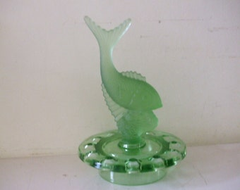 A green frosted glass figure of a fish set in a circular flower holder.art deco!
