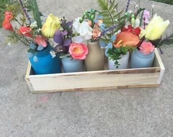 wood box with faux floral arrangement
