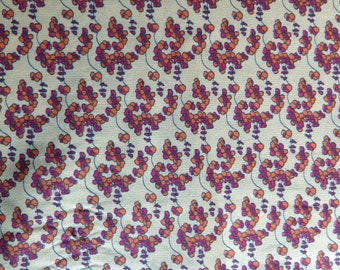 Cranberry and Orange Design on Mustard Colored Cotton Fabric