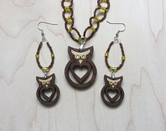 Bright eyed, big hearted glass beaded owl necklace and earring set. Walnut with maple inlay and Swarovski eyes.