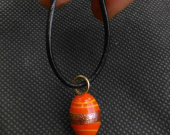 Leather with orange glass bead