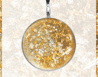 Amulet with 24 carat gold leaf and silver leaf