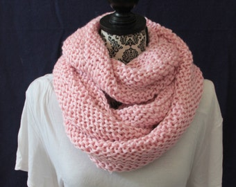 Pink hand-knit infinity scarf