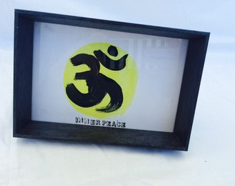 Buddhist inner peace hand painted symbol in frame