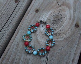 Round metal beads with smaller blue and red beads bracelet
