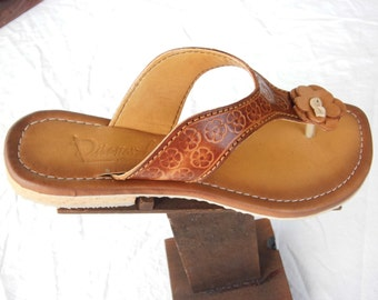 Leather sandals handmade, embossed with figures.