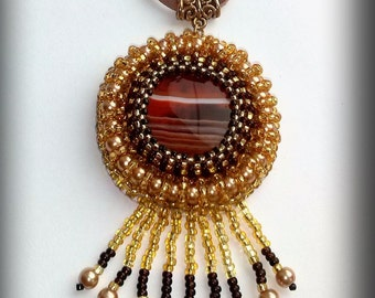 Embroidered agate pendant