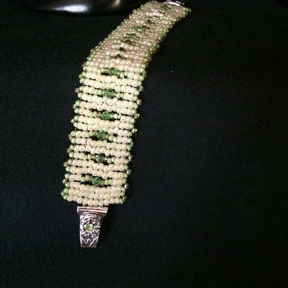 NO 62 Hand woven crystal and glass bracelet