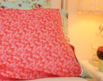 Red/Pink pillow sham with blue/ rosette cuff. White crochet trim