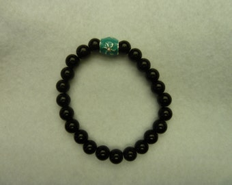 Black pearl bracelet with turquoise flower bead