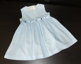 Beautiful little girl's dress with ribbon trim, lined bodice and zipped back.