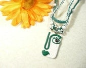 Hemp Necklace Face Pendant, Macrame Jewelry, Hippie Jewelry, Flower Beads, Polymer Clay Contemporary Face, Green and White