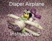 DIAPER AIRPLANE e-book INSTRUCTIONS. Completely made from diapers, washcloths, bottle, etc. Easy 2 follow guide.