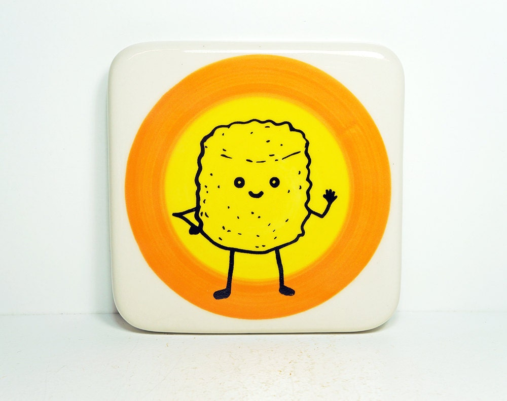 tile featuring Mr.T.Tot, waving hello, on a color block of orange and yellow. Made to Order.