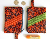 dark gray and orange floral credit card zipper pouch. Gray coin purse. zipper wallet. front ruffle. gift card holder and chapstick