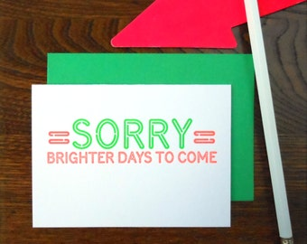 SALE 50% OFF letterpress sorry neon sign greeting card fluorescent green & orange ink on bright white paper sorry brighter days to come