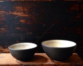 Ships Now- 2 small bowls , stoneware. Black matte glaze with white crayer inside by sara paloma