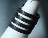 Blackened oxidized brass spiral ring, one piece (item ID HN00484B)