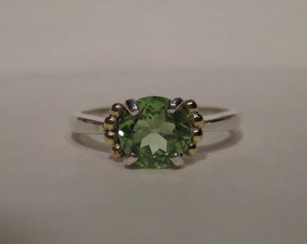 Peridot Ring .....Sterling Silver and 14 kt Yellow Gold ..            size 6 1/2  ....                               e803