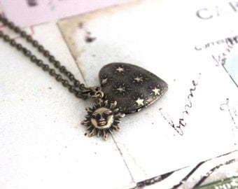 sun. heart locket necklace. in brass ox with star pattern