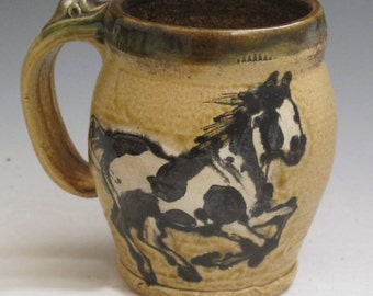Mug with paint horses slip trailed  pottery