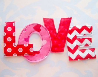 Red and White Sewn Fabric Applique Letters Embellishment LOVE