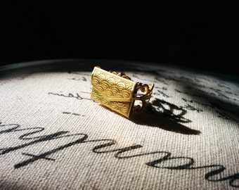 Envelope locket ring - little gold envelope opens to put your secret message inside. Perfect gift for a loved one
