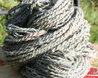 Platinum, thick and thin handspun yarn from wool blend batts.  2 ply. 84 yards