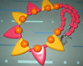 Vintage MOD Pink Yellow and Orange Geometric Shape Lucite Plastic Necklace