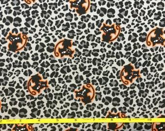 "Halloween Black Cats on Leopard cotton lycra knit fabric 58"" wide"