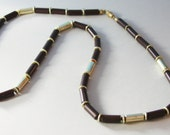 Sarah Coventry Necklace Gold Tone Spacers and Brown Tubed Beads  1960s  No. N0001