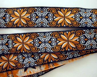 8 ft+  ICELANDIC narrow Jacquard trim. White, rusty orange on black. 7/8 inch wide. R18A