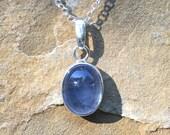 Sterling silver pendant with large oval blue aquamarine bezel set cabochon