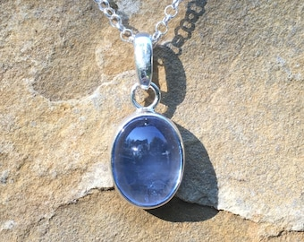 Sterling silver pendant with large oval blue aquamarine bezel set cabochon