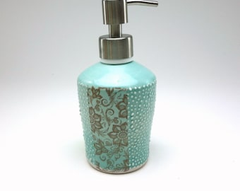 Aquamarine glazed porcelain soap dispenser with with floral pattern, dots and brushed nickel pump