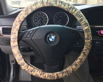 Sock Monkey on Tan Steering Wheel Cover