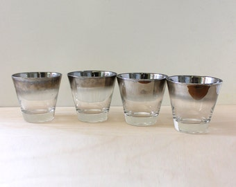 Set of four vintage Dorothy Thorpe shot glasses.