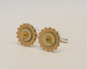 Steampunk cuff link with brass gears.