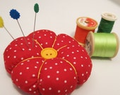 Pin cushion in red polka dot with yellow button