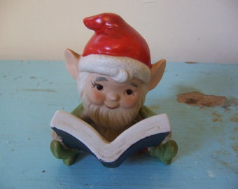 homco gnome with a book figurine