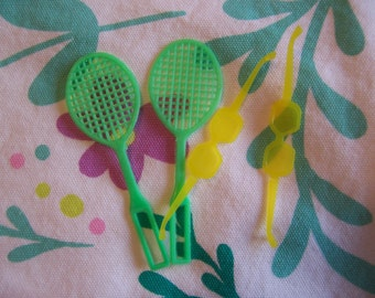 barbie doll tennis rackets and sunglasses