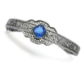 Art Deco Jewelry Silver Filigree Bracelet - Rhodium Plated, Paste Stones, Topaz Blue Glass Hinged Bangle