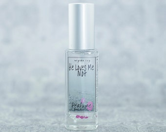 He Loves Me Not a Darkly Sweet Fragrance with Notes of Vanilla, Jasmine, Orchid, Musk, and Wood