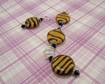 Tiger striped stitch markers